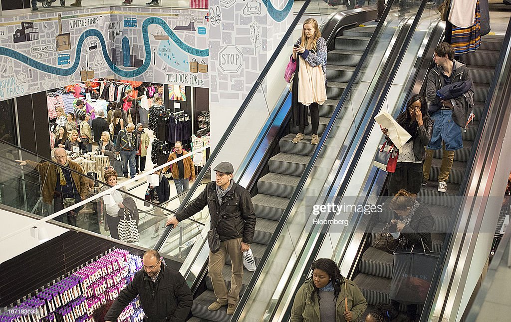 Customers stand on escalators whilst shopping inside a Primark store on Oxford Street in central London, U.K., on Monday, April 22, 2013. Associated British Foods Plc, the owner of the Primark discount-clothing chain, fell the most in three months after Credit Suisse Group AG said it's unlikely the chain's profit growth can continue at the first half's pace. Photographer: Jason Alden/Bloomberg via Getty Images