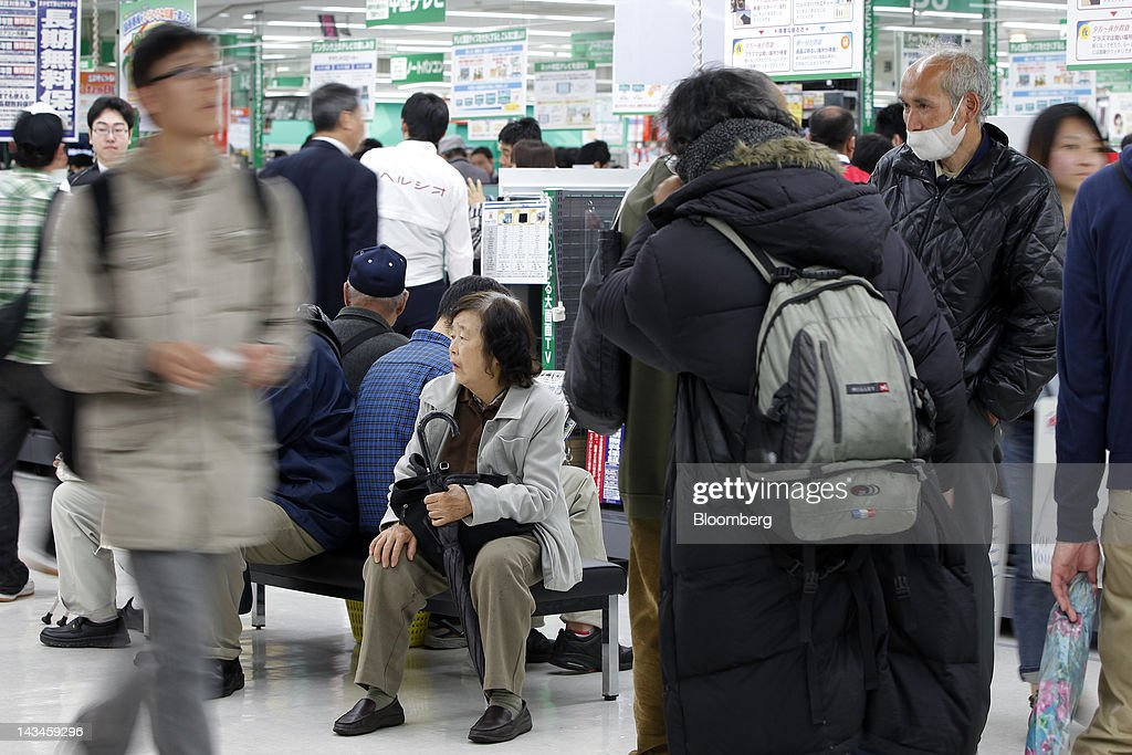 Customers take a rest from their shopping at the newly opened Labi Ofuna electronics store, operated by Yamada Denki Co., in Yokohama City, Kanagawa Prefecture, Japan, on Friday, April 27, 2012. Consumer prices excluding fresh food rose 0.2 percent from the year before, exceeding estimates, a government report showed earlier today. Photographer: Kiyoshi Ota/Bloomberg via Getty Images
