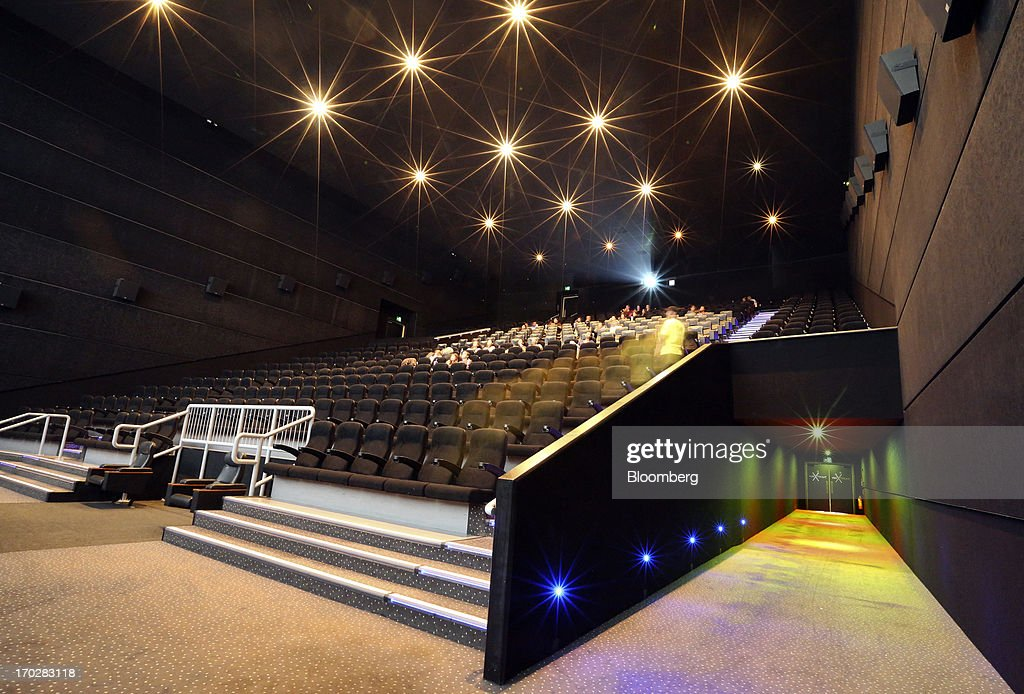 Customers take their seats in front of a screen ahead of a 3-D film at a Vue Cinema, operated by Vue Entertainment Ltd., at the Westfield Stratford City retail complex in London, U.K., on Tuesday, June 4, 2013. Vue Entertainment, the U.K. cinema chain bought by private equity firm Doughty Hanson & Co., are continuing to expand in Europe, recently acquiring Poland's second-largest cinema chain Multikino. Photographer: Chris Ratcliffe/Bloomberg via Getty Images