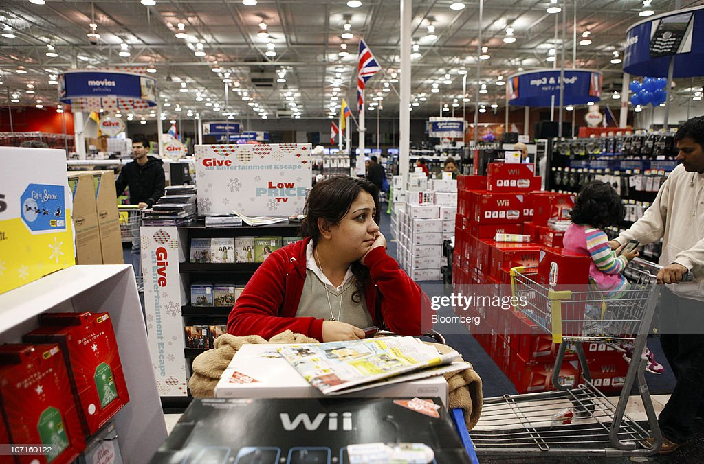 A customers takes a break from shopping at a Best Buy store in Houston, Texas, U.S., on Friday, Nov. 26, 2010. Shoppers on Black Friday, the biggest shopping day of the year, are taking advantage of deals as they face down a slower economic recovery than projected. Photographer: Aaron M. Sprecher/Bloomberg via Getty Images