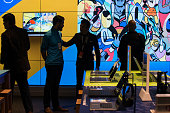 Customers talk with one another at Microsoft's first flagship store on Fifth Avenue on October 26 2015 in New York City Hundreds of eager customers...