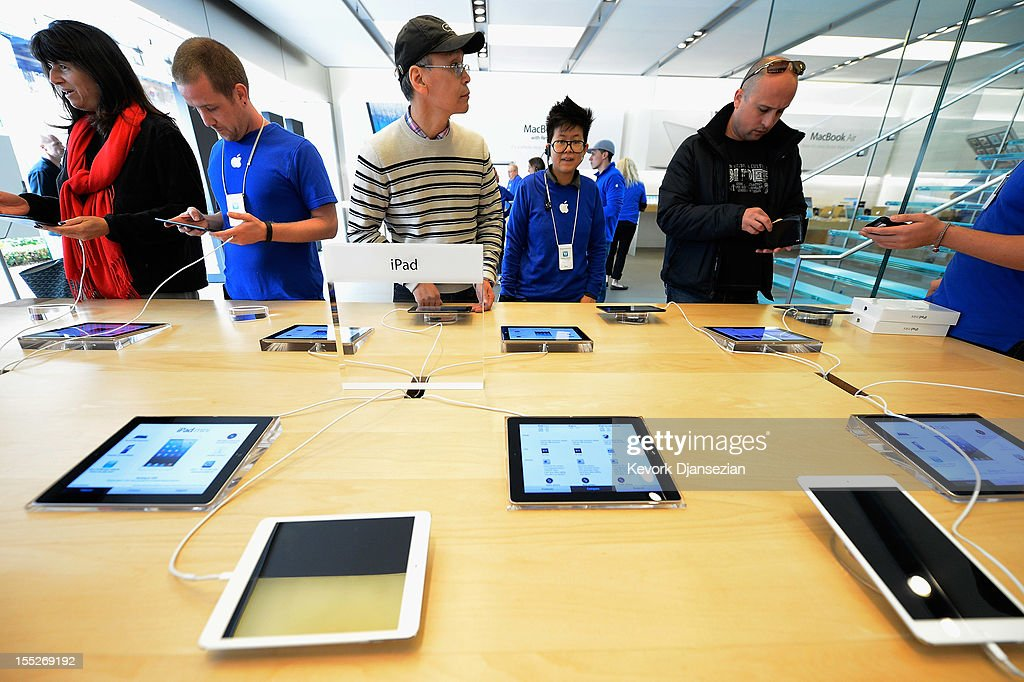 Customers test out the new iPad minis on display at the Apple Store on November 2, 2012 in Los Angeles, California. It was reported that lines at Apple stores nationwide were short as the new iPad mini and 4th generation iPad went on sale today.