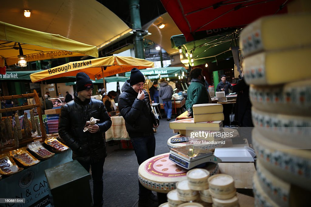 Customers try a free sample of cheese at Borough Market on February 7, 2013 in London, England. Borough Market, London's oldest since 1756, has recently completed renovation and today had it's first day of full trading.
