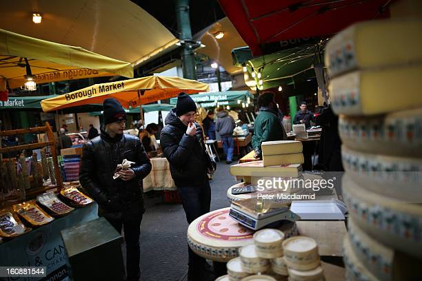 Customers try a free sample of cheese at Borough Market on February 7 2013 in London England Borough Market London's oldest since 1756 has recently...