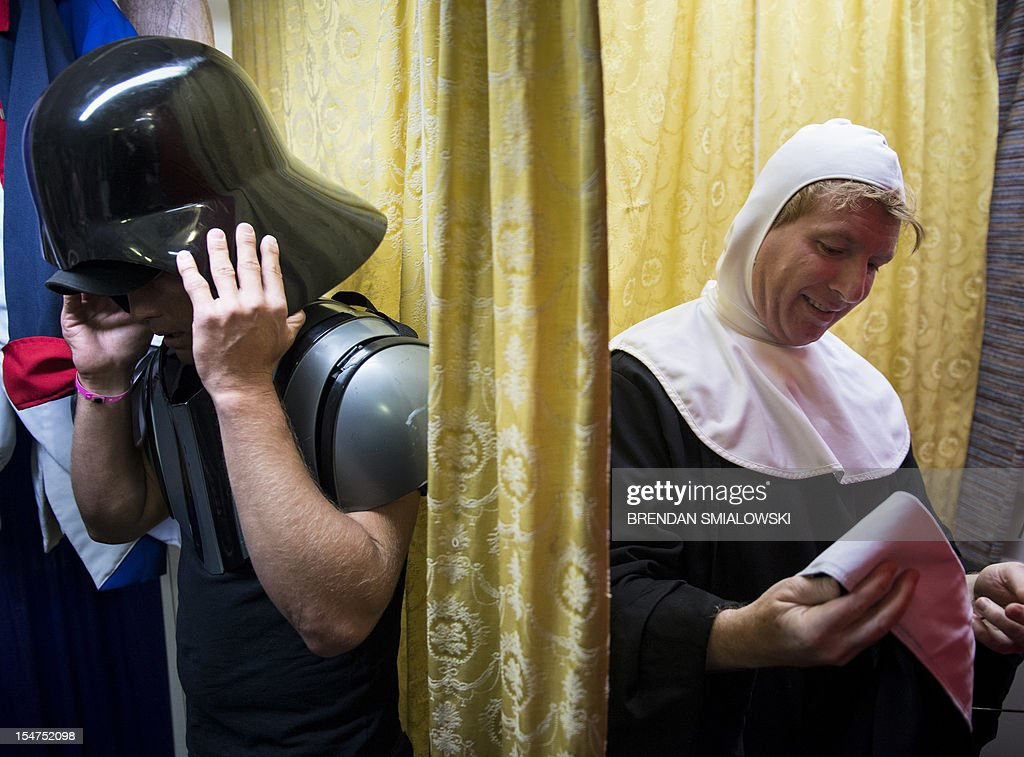 Customers try on Darth Vader and nun costumes at Backstage on October 25, 2012 in Washington, DC. The store, which largely caters to theater productions, has one of its busy seasons in October as people rent and buy costumes for Halloween. AFP PHOTO/Brendan SMIALOWSKI