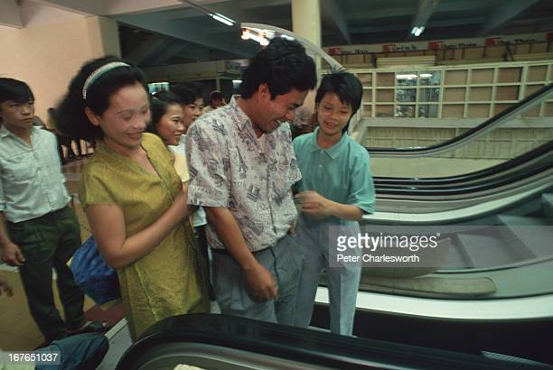Customers try Saigon's first escalator since the fall of Saigon in 1975 Prior to the Vietnam War there were a few escalators but most were broken and...