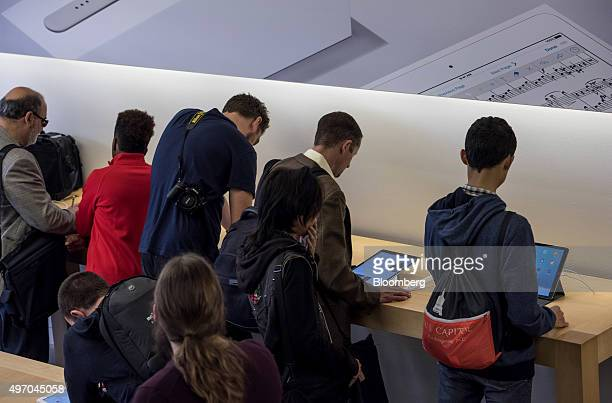 Customers try the new Apple Inc iPad Pro displayed at a store in San Francisco California US on Friday Nov 13 2015 The 129inch Apple Inc iPad Pro...