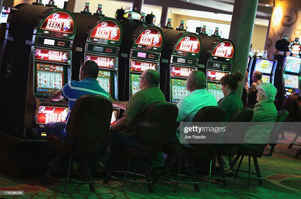 Customers try their hand at the slot machines in the casino that will hold its grand opening on Friday located in the Hialeah Park Race Track which first opened in 1925 on August 28, 2013 in Hialeah, Florida. The new casino is located in the same complex as the race track which in its heyday was known as the 'the worlds most beautiful race course.'