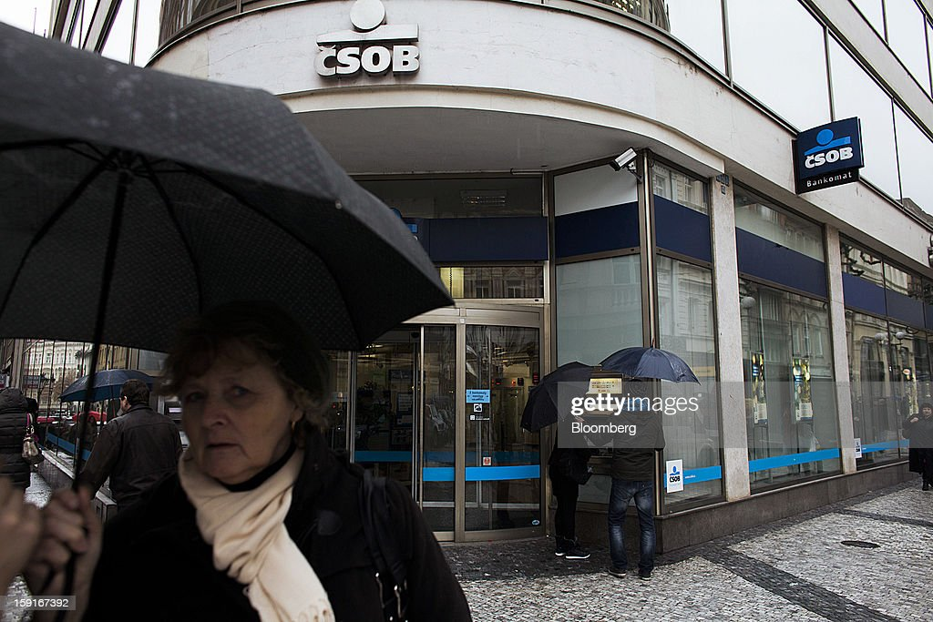 Customers use an automated teller machine (ATM) outside a CSOB AS bank branch in the financial district of Prague, Czech Republic, on Tuesday, Jan. 8, 2013. The Czech economy is showing weak domestic demand as households and businesses cut spending due to government austerity programs and the euro area's debt crisis. Photographer: Bartek Sadowski/Bloomberg via Getty Images