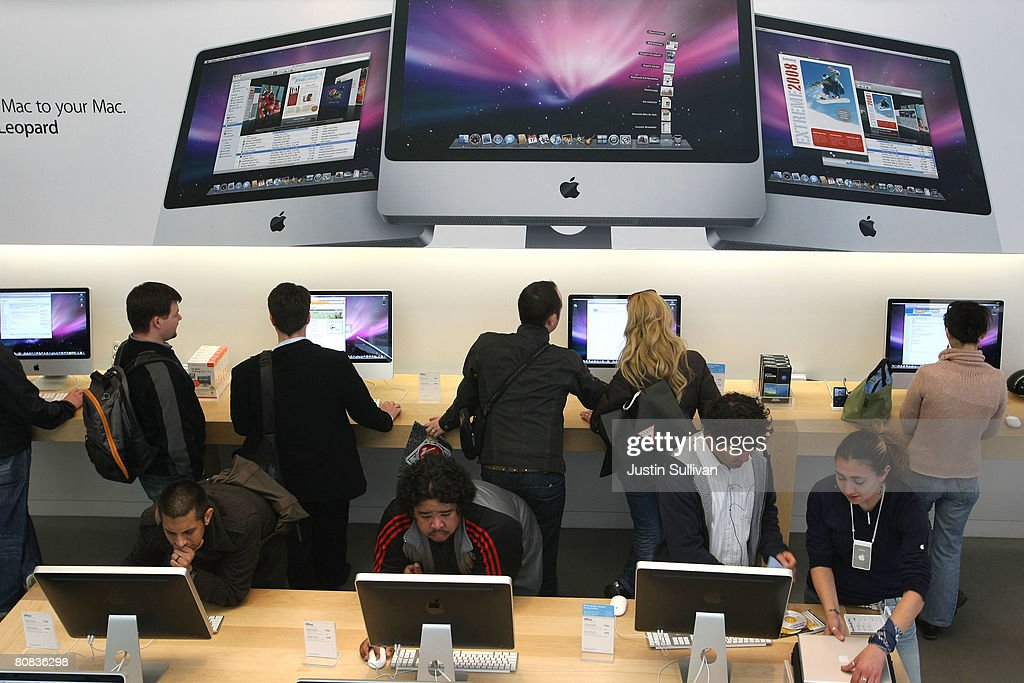 Customers use Apple iMac computers at an Apple Store April 23, 2008 in San Francisco, California. Apple reported its second quarter profits today as $1.05 billion, a 43 percent increase as compared to last year.