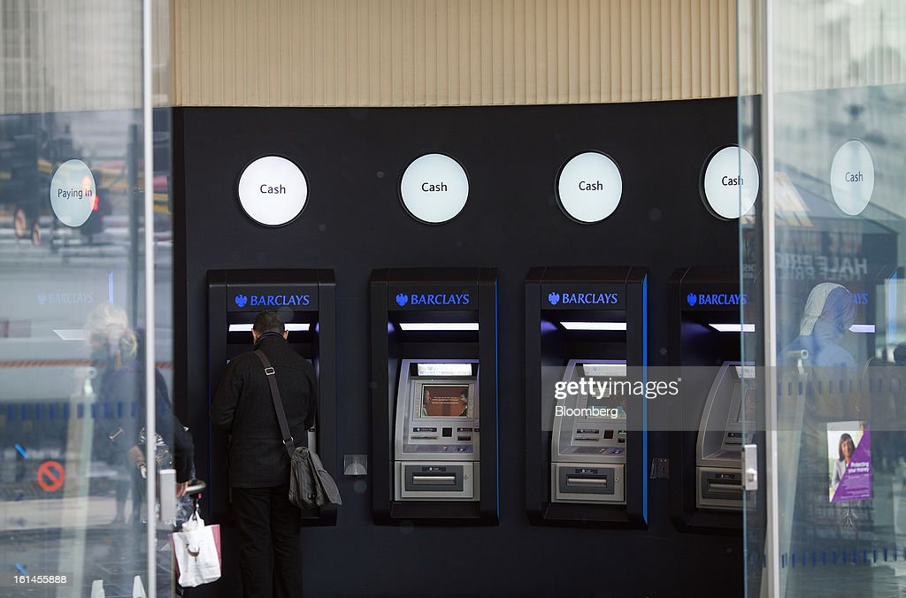 Customers use automated teller machines (ATMs) inside a Barclays Plc bank branch in London, U.K., on Monday, Feb. 11, 2013. Barclays Plc Chief Executive Officer Antony Jenkins's pledges to shred the legacy of his predecessor and fix the lender's culture are distracting from the difficulty he has in reviving profit at Britain's biggest investment bank. Photographer: Simon Dawson/Bloomberg via Getty Images