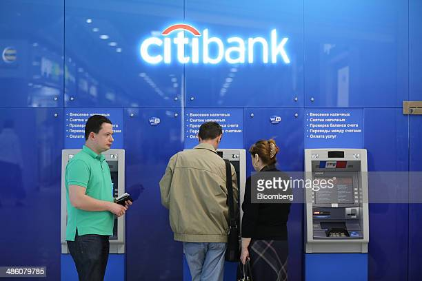Customers use automated teller machines inside a Citibank bank branch operated by Citigroup Inc in Moscow Russia on Tuesday April 22 2014 Bankers...