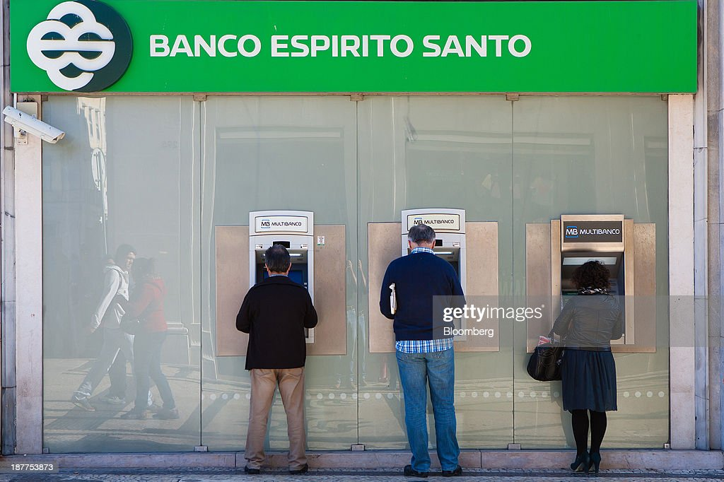 Customers use automated teller machines (ATM) outside a Banco Espirito Santo SA bank branch in Lisbon, Portugal, on Tuesday, Nov. 12, 2013. Portugal's jobless rate dropped for a second quarter, falling to 15.6 percent in the three months through September as the country's economy shows signs of recovery. Mario Proenca/Bloomberg via Getty Images