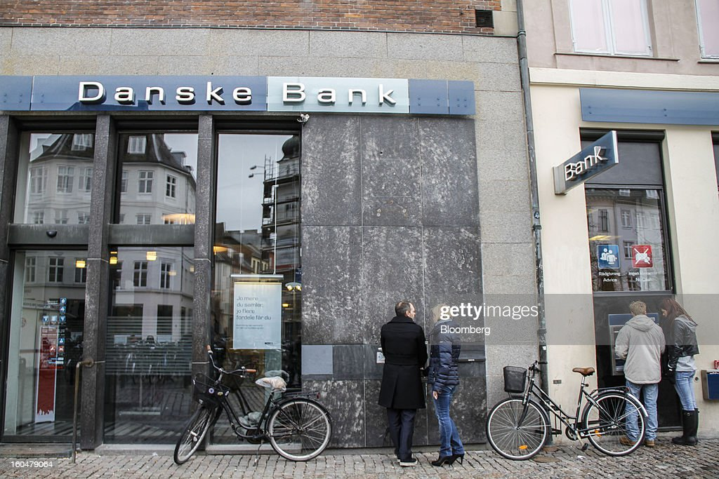 Customers use automated teller machines (ATM) outside a Danske Bank A/S branch in Copenhagen, Denmark, on Friday, Feb. 1, 2013. Danish regional banks are struggling to emerge from a burst property bubble that's forced the government resolution agency to take over a dozen lenders after losses on commercial and agricultural loans wiped out capital. Photographer: Freya Ingrid Morales/Bloomberg via Getty Images