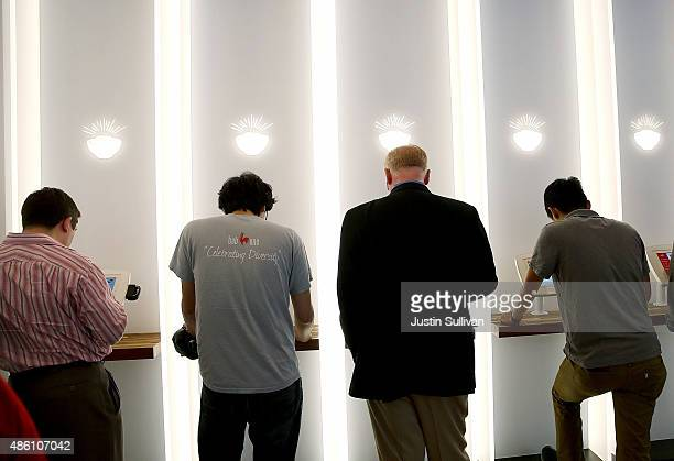 Customers use interactive kiosks to place orders at eatsa a fully automated fast food restaurant on August 31 2015 in San Francisco California eatsa...