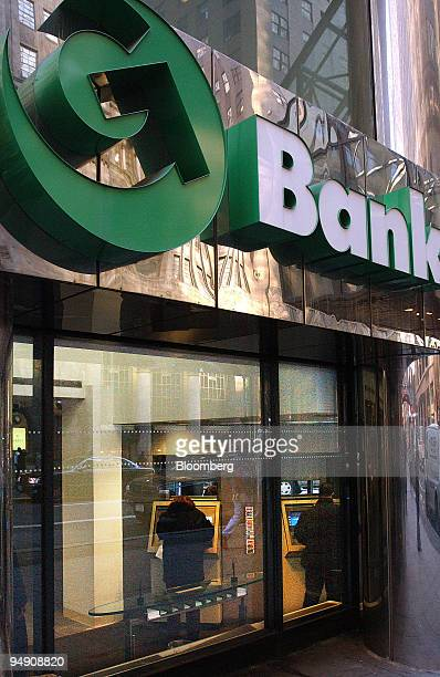 Customers use the automated teller machines at a GreenPoint Bank branch in New York on Wednesday February 4 2004 GreenPoint Financial Corp the...