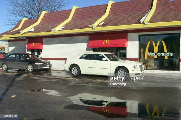 Customers use the convenience of the driveup windows as they order food at a McDonald's restaurant in Evanston Illinois on Thursday January 27 2005...
