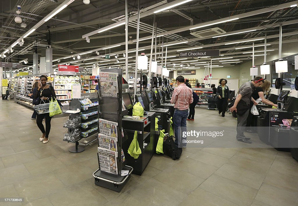 Customers use the self-service check-out points inside the Marks & Spencer Group Plc (M&S) food hall in the Westfield Stratford City retail complex in London, U.K., on Thursday, June 27, 2013. U.K. retail sales rose more than economists forecast in May as consumers spent more online and food sales increased at their fastest pace for more than two years. Photographer: Chris Ratcliffe/Bloomberg via Getty Images