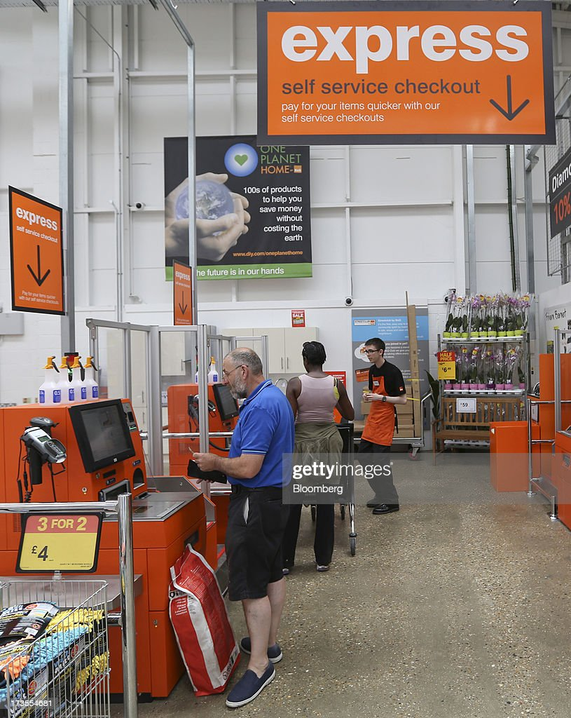 Customers use the self-service checkouts inside a B&Q home improvement store, operated by Kingfisher Plc, in London, U.K., on Tuesday, July 16, 2013. Financial assistance for first-time home buyers in Britain is likely to prompt a resurgence of do-it-yourself spending after several years of decline, according to Kingfisher Plc Chief Executive Officer Ian Cheshire. Photographer: Chris Ratcliffe/Bloomberg via Getty Images