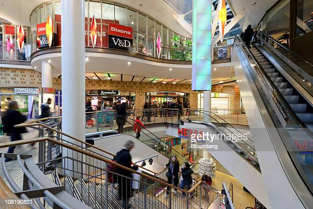 Customers use the stairs and escalators in the Kalvertoren shopping center in Amsterdam Netherlands on Wednesday Jan19 2011 European stocks fell for...