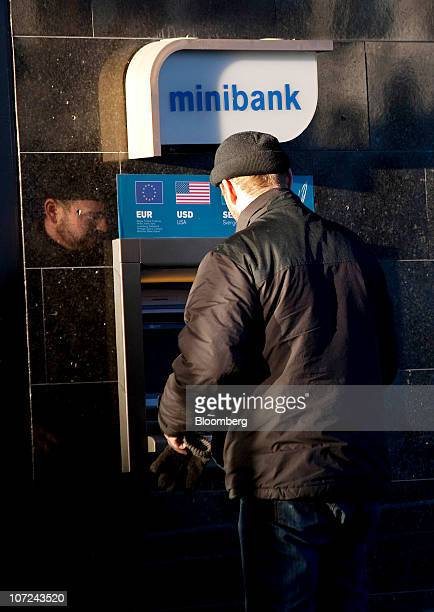 A customers uses a Nordea Bank AB ATM in Oslo Norway on Wednesday Dec 1 2010 Norwegian manufacturing expanded last month at the fastest pace since...