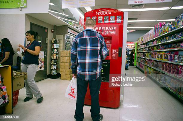 A customers uses a selfservice Redbox video rental kiosk is seen in a Walgreen's drug store in New York on Wednesday November 2 2011