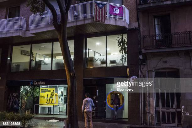 A customers uses an automated teller machine outside a CaixaBank SA bank branch in Barcelona Spain on Friday Oct 20 2017 In a video posted...