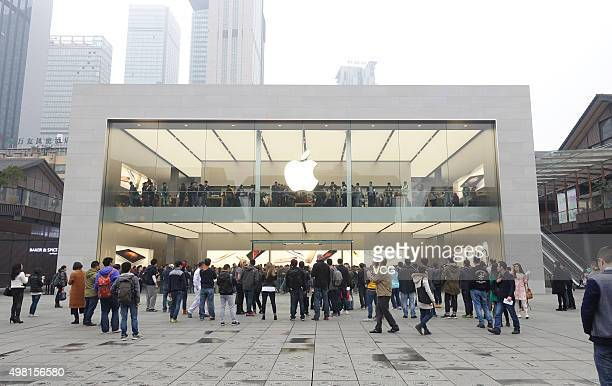 Customers view Apple products at the Chengdu's second Apple Store in Taikoo Li on November 21 2015 in Chengdu Sichuan Province of China The first...