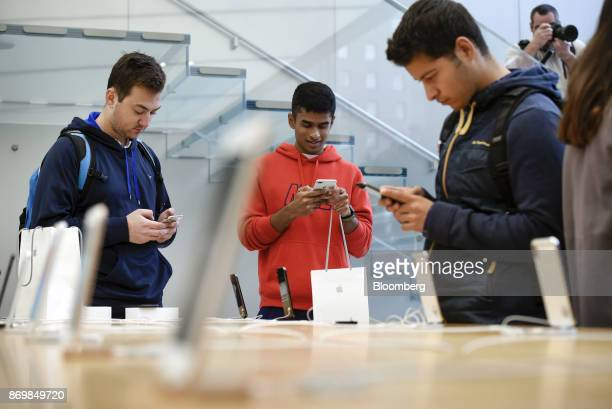 Customers view the Apple Inc iPhone X smartphone during the sales launch at a store in San Francisco California US on Friday Nov 3 2017 The $1000...