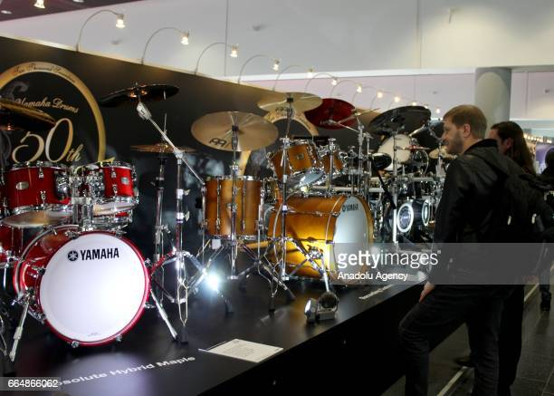 Customers view the drum sets presented at the International Trade Fair for musical instruments sheet music music production and marketing...