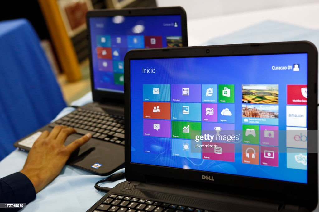 A customers views a Dell Inc. Inspiron 15 laptop during an event at a Curacao Department store in Los Angeles, California, U.S., on Wednesday, August 7, 2013. The Inspiron 15, an affordable notebook with an impressive battery life, is the only Spanish-language laptop manufactured and sold in the U.S. offered by Dell. Photographer: Patrick T. Fallon/Bloomberg via Getty Images