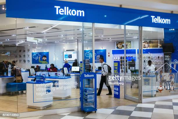 Customers visit a phone store operated by Telkom SA SOC Ltd at the Menlyn Park shopping center in Pretoria South Africa on Tuesday July 25 2017 South...