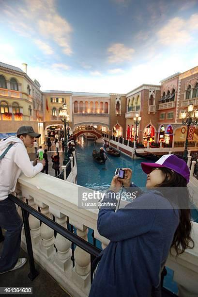 Customers visit the Venetian casino's shopping mall on February 24 2008 in Macau China The Venetian MacaoResortHotel is a 163000 square foot casino...
