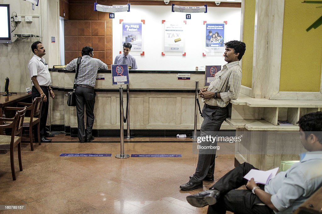 Customers wait at a HDFC Bank Ltd. bank branch in Mumbai, India, on Friday, Feb. 1, 2013. HDFC Bank, India's second-largest lender by market value, is seeking to expand in the rural market of the world's second-most populated nation to bolster profits as competition in its cities intensifies. Photographer: Dhiraj Singh/Bloomberg via Getty Images