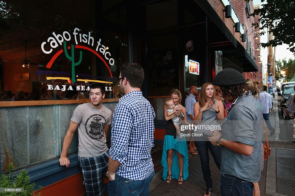Customers wait for an available table outside Cabo Fish Taco restaurant on July 11, 2012 in Charlotte, North Carolina. Cabo Fish Taco is located in NoDa, Charlotte's historic arts district known for its galleries, performance venues and funky restaurants. Businesses in Charlotte are anticipating a boost in sales when the city hosts the 2012 Democratic National Convention (DNC) September 3-6.