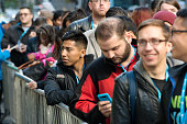 Customers wait for the grand opening of Microsoft's first flagship store on Fifth Avenue on October 26 2015 in New York City Hundreds of eager...