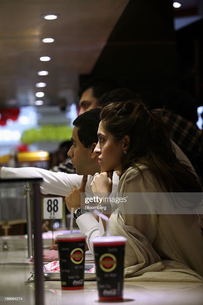 Customers wait for their orders at a Fatburger outlet in Karachi, Pakistan, on Saturday, Jan. 5, 2013. Fatburger opened its first outlet in Pakistan to the public on Jan. 5. Photographer: Asim Hafeez/Bloomberg via Getty Images
