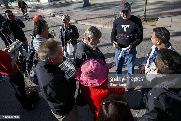 Customers wait in line ahead of the Model 3 announcement outside the Tesla Motors Inc store on the Third Street Promenade in Santa Monica California...