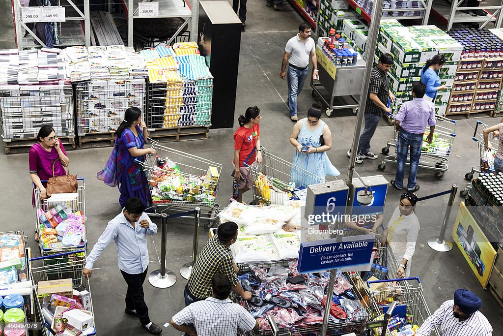 Customers wait in line at a checkout counter inside a Walmart India Pvt. Best Price Modern Wholesale store in the town of Zirakpur on the outskirts of Chandigarh, Punjab, India, on Tuesday, June 10, 2014. India's consumer price index (CPI) figures and wholesale price inflation figures for May are scheduled for release on June 12 and 16 respectively. Photographer: Udit Kulshrestha/Bloomberg via Getty Images