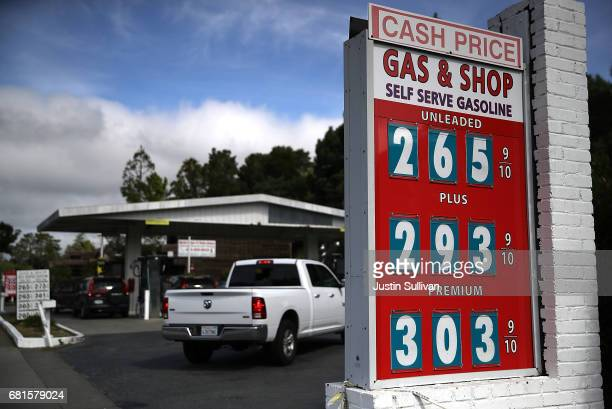 Customers wait in line at a gas station on May 10 2017 in San Anselmo California California Gov Jerry Brown is set to announce his revised State...