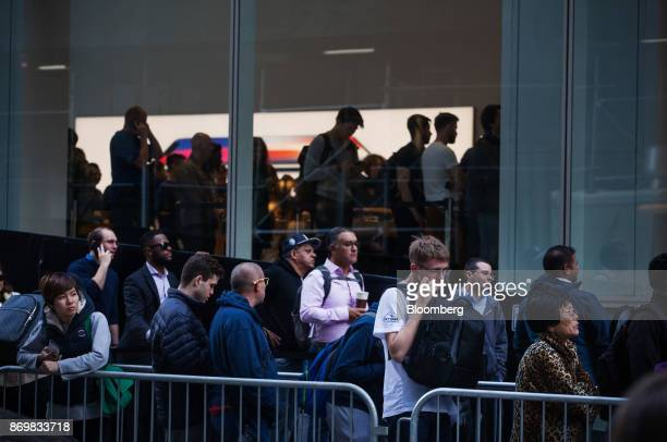 Customers wait in line at a store ahead of the sales launch for the Apple Inc iPhone X smartphone at a store in New York US on Friday Nov 3 2017 The...