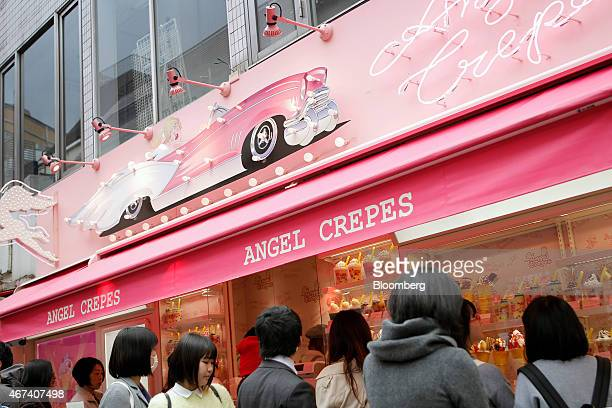 Customers wait in line at creperie in the Harajuku district of Tokyo Japan on Monday March 23 2015 Bank of Japan Governor Haruhiko Kuroda last week...