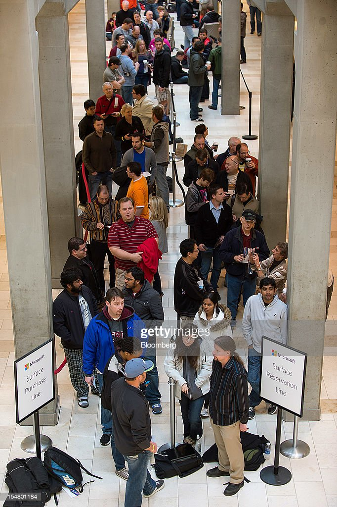 Customers wait in line at the opening of a Microsoft Corp. store in Bellevue, Washington, U.S., on Friday, Oct. 26, 2012. Microsoft Corp. introduced the biggest overhaul of its flagship Windows software in two decades, reflecting the rising stakes in its competition with Apple Inc. and Google Inc. for the loyalty of customers who are shunning personal computers and flocking to mobile devices. Photographer: Stuart Isett/Bloomberg via Getty Images