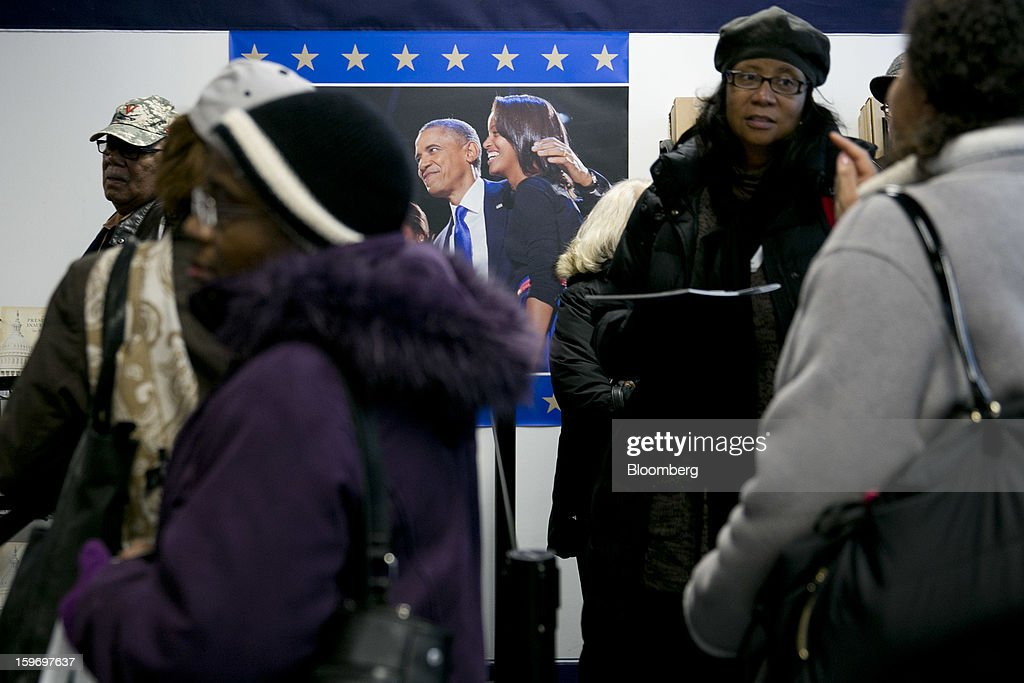 Customers wait in line at the Presidential Inaugural Committee store in Washington, D.C., U.S., on Friday, Jan. 18, 2013. President Barack Obama's second inauguration next week will combine the star power of Beyonce, Kelly Clarkson and James Taylor with a lineup that reflects social values Obama will champion in his new term. Photographer: Andrew Harrer/Bloomberg via Getty Images
