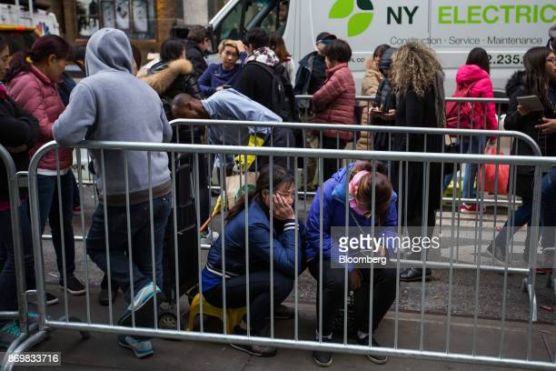 Customers wait in line outside a store ahead of the sales launch for the Apple Inc iPhone X smartphone at a store in New York US on Friday Nov 3 2017...