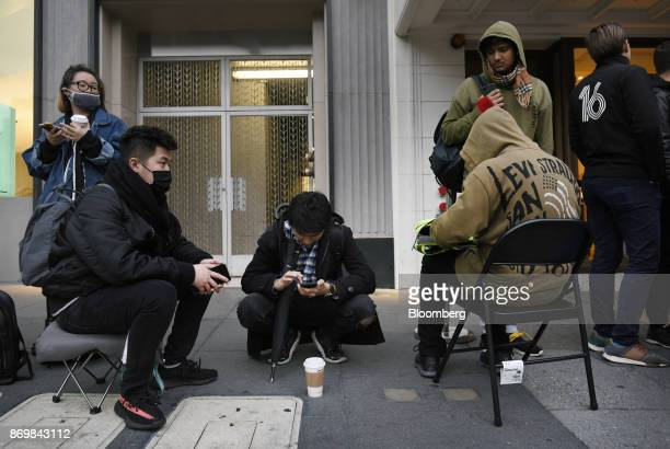 Customers wait in line outside a store ahead of the sales launch for the Apple Inc iPhone X smartphone in San Francisco California US on Friday Nov 3...