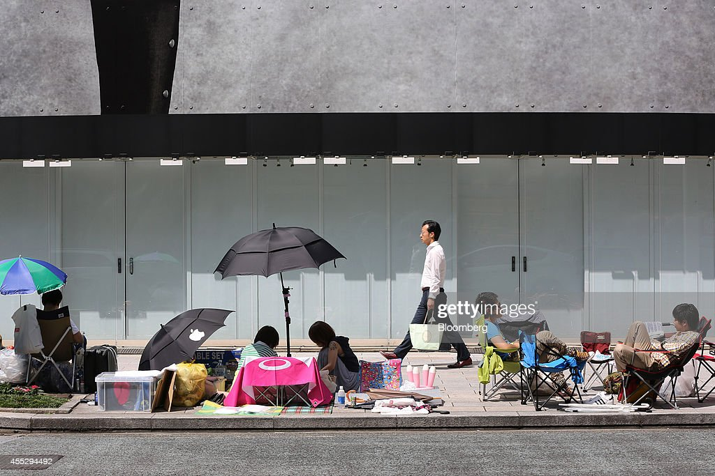customers-wait-in-line-outside-apple-incs-ginza-store-ahead-of-the-picture-id455294492