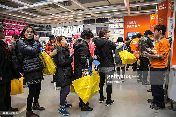 Customers wait in line to become a member of the Ikea Family Ikea AB's loyalty program at the company's store in Gwangmyeong Gyeonggi province South...