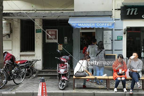 Customers wait in line to buy coffee at a 2squaremeter cafe named Manner Coffee stands at Nanyang Road on June 4 2016 in Shanghai China The...
