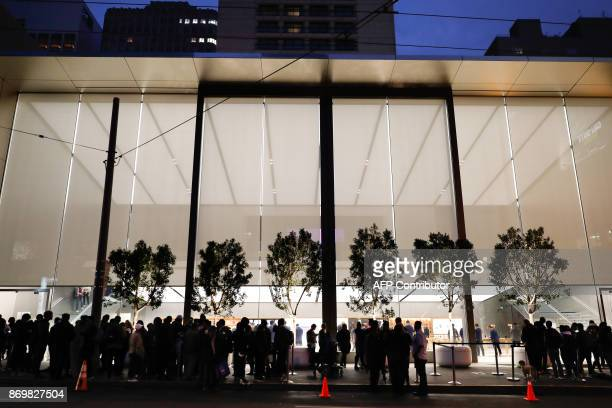 Customers wait in line to buy the iPhone X outside the Apple Store Union Square on November 3 in San Francisco California Apple's flagship iPhone X...